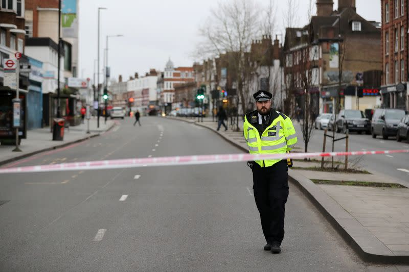 Police is seen near a site where a man was shot by armed officers in Streatham