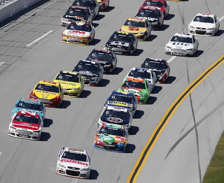 Dale Earnhardt Jr. (88) leads the pack during the NASCAR Aaron's 499 Sprint Cup series auto race at Talladega Superspeedway, Sunday, May 4, 2014, in Talladega, Ala