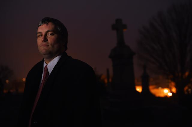 Here's Brett Talley posing for a portrait in a cemetery. In addition to being nominated to a lifetime court seat for some reason, he writes horror stories. (The Washington Post via Getty Images)