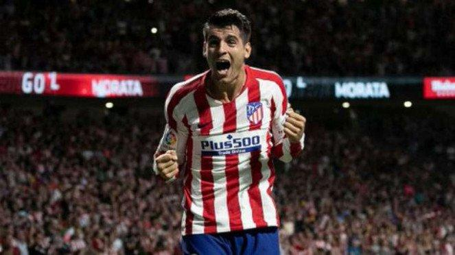 Striker Atletico Madrid, Alvaro Morata rayakan gol.