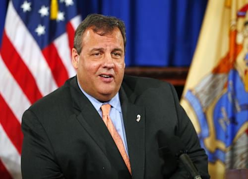 """FILE - In this June 10, 2013 file photo, New Jersey Gov. Chris Christie announces a partnership between Cooper University Health Care and MD Anderson Cancer Center during a press conference at the State House in Trenton, N.J. On Monday, July 15, Christie's office confirmed a report in The Huffington Post that the Republican governor will appear as himself on an episode this fall of NBC's new comedy, """"The Michael J. Fox Show."""" The show premieres Sept. 26. NBC did not announce an air date for the Christie episode. The governor is now running for a second term. The election is Nov. 5. (AP Photo/Rich Schultz, File)"""
