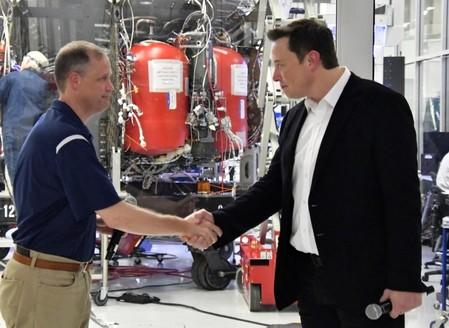 NASA Administrator Jim Bridenstine and SpaceX Chief Engineer Elon Musk shake hands after a tour of SpaceX headquarters in Hawthorne