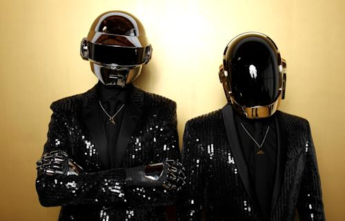 FILE - In this April 17, 2013 file photo, Thomas Bangalter, left, and Guy-Manuel de Homem-Christo, from the group Daft Punk pose for a portrait in Los Angeles. The Recording Academy announced Thursday, Dec. 19, 2013, that Daft Punk will perform at the Grammy Awards show on Jan. 26, 2014. (Photo by Matt Sayles/Invision/AP, File)