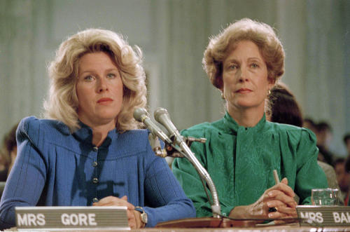FILE - In this Sept. 19, 1985 file photo, Tipper Gore, wife of Sen. Al Gore Jr. (D-Tenn.), left, and Susan Baker, wife of Secretary of State James A. Baker, appear at a Parents Music Resource Center committee hearing in Washington. The PMRC campaigned to get the music industry to put warning labels on content with explicit lyrics. (AP Photo/Lana Harris)
