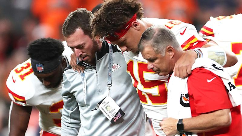 Patrick Mahomes was assisted off the field. (Photo by Matthew Stockman/Getty Images)