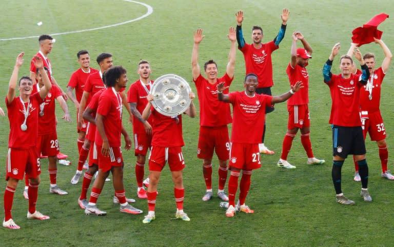 Bayern Munich players celebrate with the Bundesliga trophy on Saturday