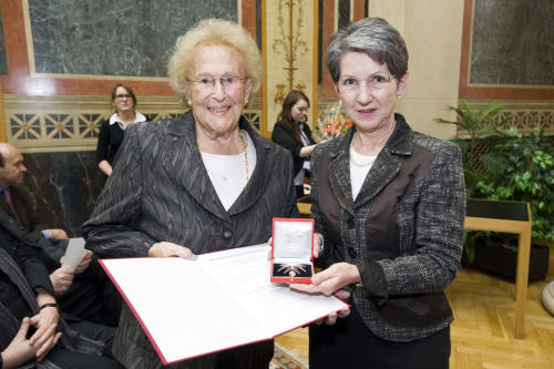 In this Aug. 31, 2012 photo provided by the Austrian parliament 95 year-old soprano Hilde Zadek, left, receives the Great Medal of Honor of the Austrian Republic bey the speaker of the parliament Barbara Prammer, right, at the parliament in Vienna, Austria. For Zadek, the city she once despised as part of Hitler's evil empire has long become a home that she says she would never leave _ and one that is proud to call her own. She has been showered with medals, granted high honorary titles and a singer's competition named after her 13 years ago has turned into an international launching pad for future opera stars. (AP Photo/Parlamentsdirektion/Bildagentur Zolles KG/Jacqueline Godany)