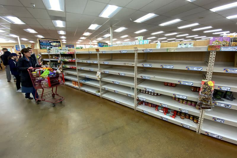 Shelves previously filled with pasta and canned food are seen empty at a Trader Joe's grocery store as shoppers gather supplies with coronavirus fears spreading in Encinitas, California