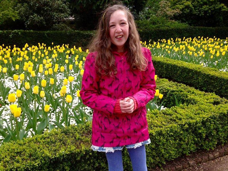 This undated photo released by The Lucie Blackman Trust/Family shows Nora Anne Quoirin standing in a garden.