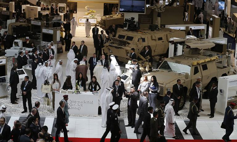 "People visit during the opening of the International Defence Exhibition and Conference (IDEX) at the Abu Dhabi National Exhibition Centre in the Emirati capital on February 17, 2013. A top French defence industry official said that talks to sell Rafale jet fighters to the UAE were ""progressing well"", expressing confidence that a deal could be reached with the Gulf state."