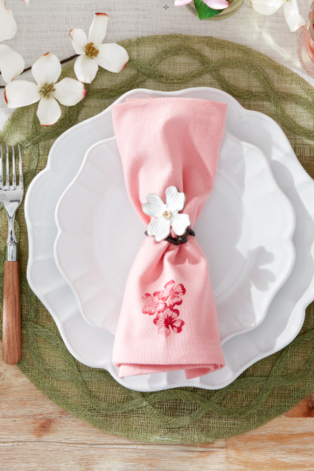 """<p>Yes, you can actually recreate these beautiful napkins at home—no embroidery required. Just roll a floral stamp with a thin layer of <a href=""""https://www.amazon.com/Tulip-41438-Dimensional-Fabric-Paint/dp/B0011451HQ"""" target=""""_blank"""">fabric paint</a> and apply it to light pink linens. Easy!</p><p><a class=""""body-btn-link"""" href=""""https://www.amazon.com/Tulip-41438-Dimensional-Fabric-Paint/dp/B0011451HQ?tag=syn-yahoo-20&ascsubtag=%5Bartid%7C10050.g.1652%5Bsrc%7Cyahoo-us"""" target=""""_blank"""">SHOP RED FABRIC PAINT</a></p>"""