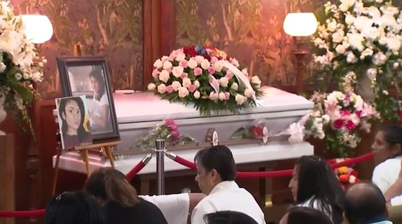 Marlen Ochoa-Lopez's casket inside the Chicago funeral home ahead of Saturday's service. A photo of her on her wedding was next to the casket.