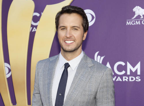 "FILE - This April 1, 2012 file photo shows country singer Luke Bryan at the 47th Annual Academy of Country Music Awards in Las Vegas. Bryan is joining Blake Shelton to co-host the 2013 Academy of Country Music Awards on April 7. Bryan replaces Reba McEntire, who served as host for more than a decade before stepping aside to concentrate on her new sit-com ""Malibu Country."" (AP Photo/Isaac Brekken, file)"