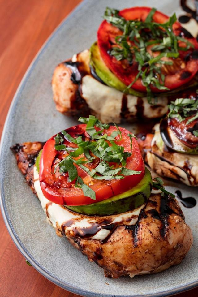 "<p>Chicken breasts topped with mozz, avocado, and tomato are everything.</p><p>Get the recipe from <a href=""/cooking/recipe-ideas/recipes/a53158/california-grilled-chicken-recipe/"" target=""_blank"">Delish</a>.</p>"