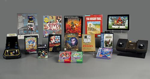 This undated photo provided by The Strong shows the 15 finalists nominated for the World Video Game Hall of Fame. The nominees were announced Tuesday, April 28, 2015, at The Strong museum in Rochester, N.Y., where the hall will be located alongside the National Toy Hall of Fame. They are, from left, Pac-Man; Space Invaders; Sonic the Hedgehog; Minecraft; the Sims; Super Mario Bros.; Doom, top; World of Warcraft, center; Pokemon series, bottom; the Legend of Zelda; the Oregon Trail; Tetris; FIFA soccer; Angry Birds; Pong. (Bethany Mosher/The Strong via AP)