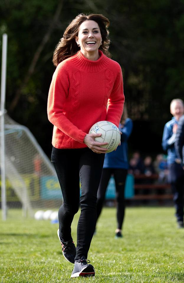 <p>Kate wore a simple red knit with skinny jeans and trainers to visit the Salthill GAA club during her visit to Ireland.</p>