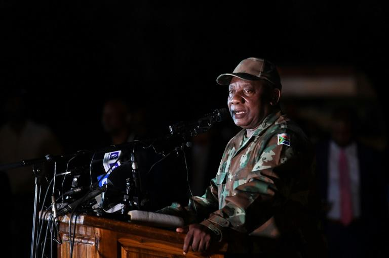 South African President Cyril Ramaphosa saw off soldiers before they deployed from a military base in Soweto township