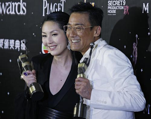 Hong Kong actress Miriam Yeung, left, and actor Tony Leung Ka Fai poses after winning the Best Actress award and Best Actor award at the 32nd Hong Kong Film Awards in Hong Kong Saturday, April 13, 2013. (AP Photo/Vincent Yu)