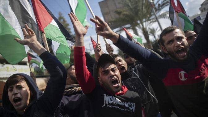 Masyarakat Palestina melakukan protes terhadap perjanjian damai antara AS dan Timur Tengah di Gaza pada 28 Januari 2020. (Source: AP/ Khalil Hamra)