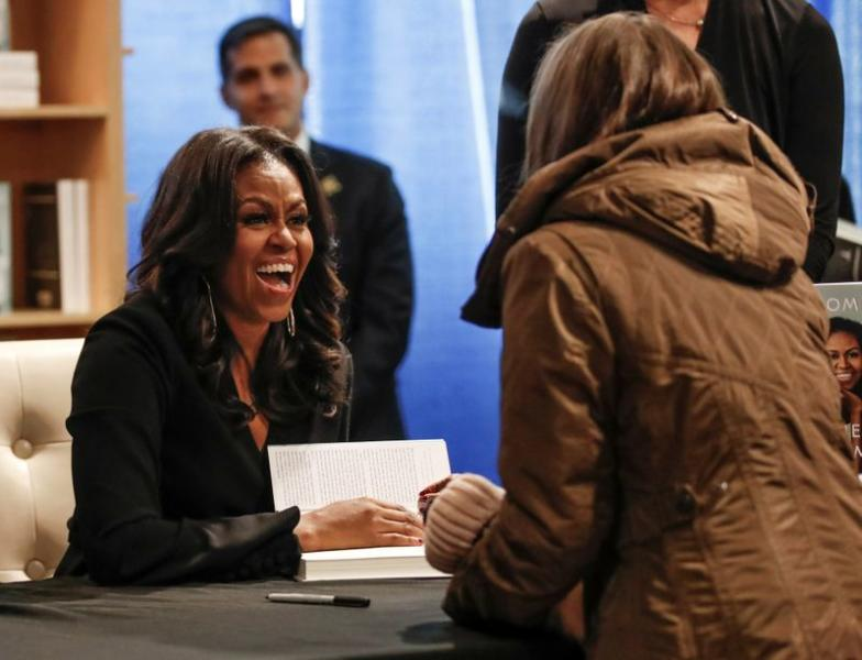 FILE PHOTO: Former first lady Michelle Obama signs copies of her memoir Becoming in Chicago