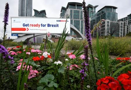 An electronic billboard displaying a British government Brexit information awareness campaign advertisement is seen in London, Britain