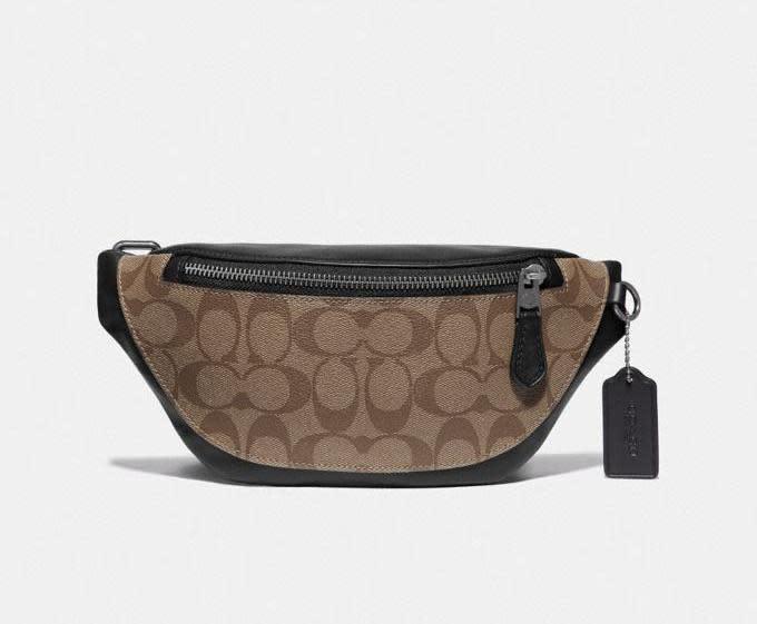 Warren Mini Belt Bag In Signature Canvas in tan. Image via Coach.