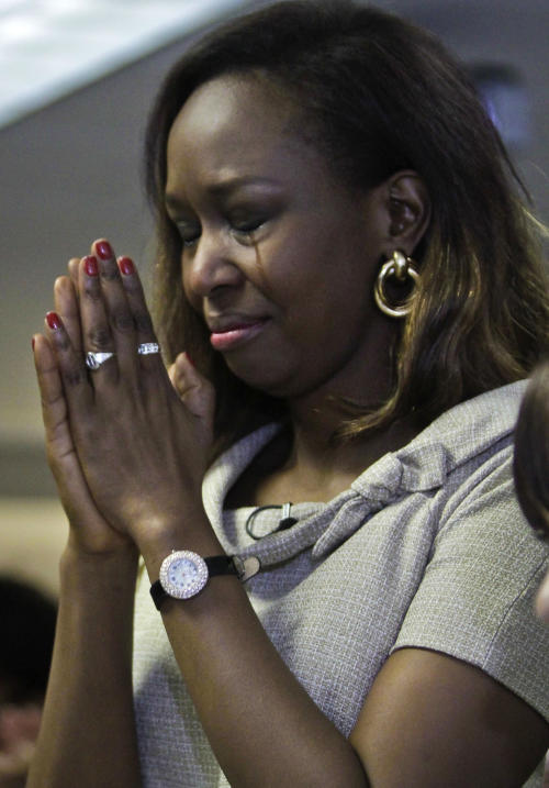 "Immaculee Ilibagiza cries as she says pledge of allegiance, during the U.S. Citizenship and Immigration Services naturalization ceremony on Wednesday, April 17, 2013 in New York. ""Who would know that this fantasy would finally happen,"" said Ilibagiza, author of the best seller ""Left to Tell, Discovering God Amidst the Rwandan Holocaust."" She sought asylum in the U.S. after fleeing the 1994 Rwandan genocide, which claimed more than 500,000 lives. (AP Photo/Bebeto Matthews)"