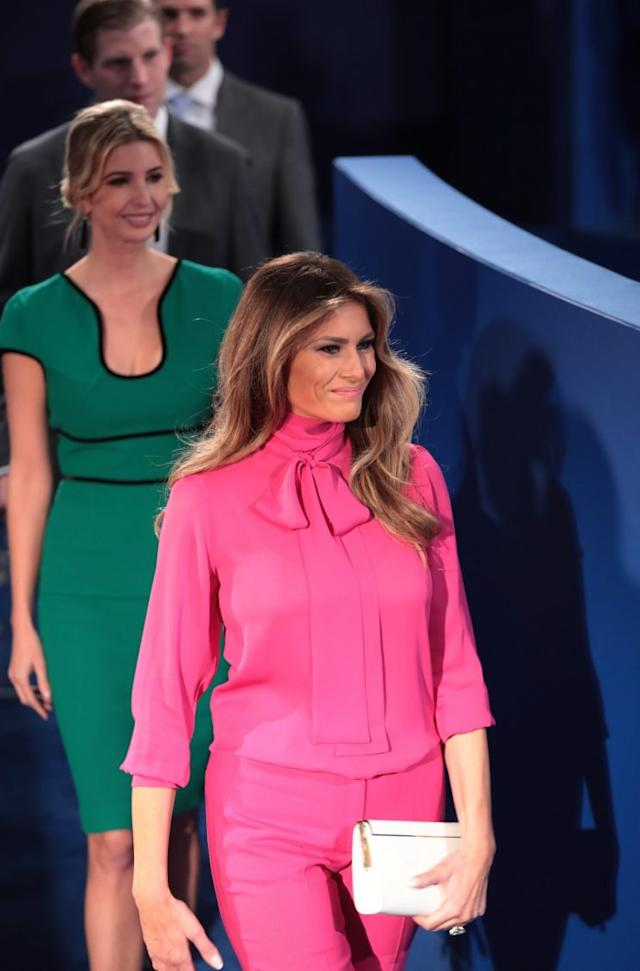 Melania Trump wore a bright pink silk crepe de chine top with a