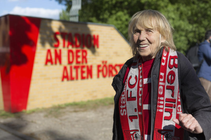"""Union Berlin fan Helga Wischke turned up for her team's biggest Bundesliga game of the season against Bayern Munich, in Berlin, Sunday, May 17, 2020, despite the match going ahead without supporters and under strict hygiene measures due to fears over the coronavirus. """"We were hoping to get something of the game, but they're not letting anyone through,"""" Wischke told The Associated Press. (AP Photo/Ciarán Fahey)"""