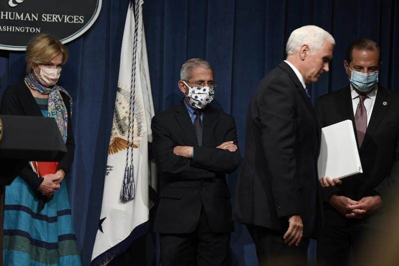 FILE - In this June 26, 2020, file photo Vice President Mike Pence, second from right, walks off of the stage following the conclusion of a briefing with the Coronavirus Task Force at the Department of Health and Human Services in Washington. Dr. Deborah Birx, left, Dr. Anthony Fauci, second from left, and Health and Human Services Secretary Alex Azar, right, follow Pence. On Friday, Pence said Americans should look to their state and local leadership for modeling their behavior. The comments only days after President Donald Trump held two campaign events that drew hundreds of participants but few wearing masks. (AP Photo/Susan Walsh, File)