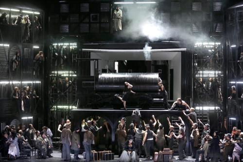 """This picture taken Friday, June 21, 2013, shows a general view during a dress rehearsal for the opera """"Il Trovatore"""" by Giuseppe Verdi in the Bavarian State Opera House in Munich, southern Germany. This wild new production by Olivier Py opened the company's annual Munich Opera Festival. It's a non-stop barrage of nightmarish images mixing styles and periods that assault the audience at lightning speed on a multi-tiered revolving set. (AP Photo/Matthias Schrader)"""