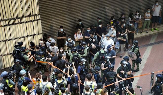Police stop and search people in Causeway Bay amid scattered protests on Thursday. Photo: Sam Tsang