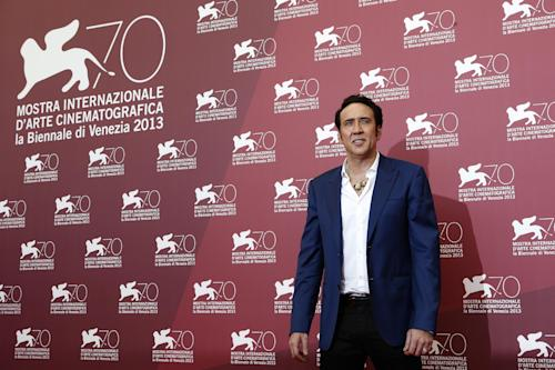 Actor Nicolas Cage poses for photographer at the photo call for the film Joe at the 70th edition of the Venice Film Festival held from Aug. 28 through Sept. 7, in Venice, Italy, Friday, Aug. 30, 2013. (AP Photo/David Azia)