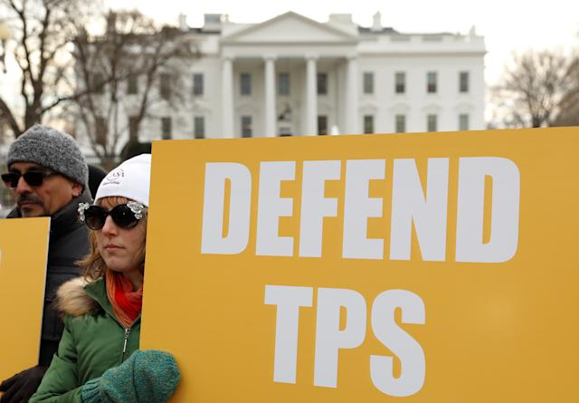 Demonstrators rally outside the White House on Jan. 8 to protest the termination of temporary protected status for Salvadorans. The majority of Americans oppose Trump's immigration policies, according to a new poll. (Kevin Lamarque / Reuters)