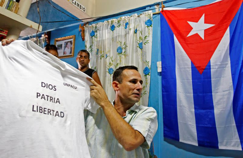 Cuba puts leading dissident on trial, his supporters say