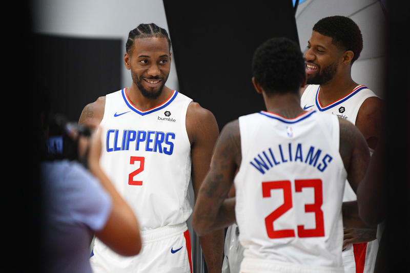 PLAYA VISTA, CA - SEPTEMBER 29: Los Angeles Clippers Forward Kawhi Leonard (2), Los Angeles Clippers Forward Paul George (13) and Los Angeles Clippers Guard Lou Williams (23) pose for a photo during media day at the Los Angeles Clippers Training Center on September 29, 2019 in Playa Vista, California. (Photo by Brian Rothmuller/Icon Sportswire via Getty Images)