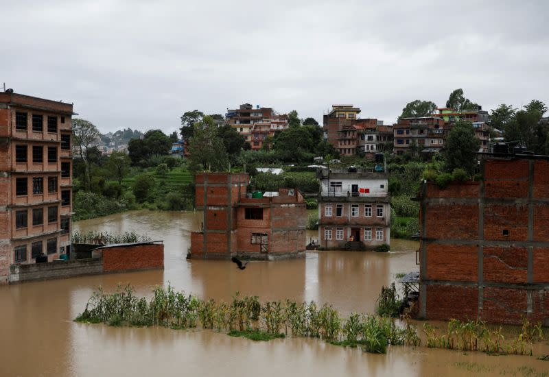 Heavy rains kill four of Nepal family; floods ease in India