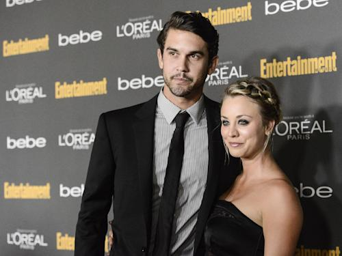 """FILE - This Sept. 20, 2013 file photo shows actress Kaley Cuoco, right, and Ryan Sweeting at the 2013 Entertainment Weekly Pre-Emmy Party in Los Angeles. The Big Bang Theory"""" star, Cuoco, is starting 2014 off as a Mrs. The 28-year-old actress wed 26-year-old tennis pro Ryan Sweeting in a New Year's Eve ceremony in Calif, her rep confirms. (Photo by Dan Steinberg/Invision/AP, File)"""