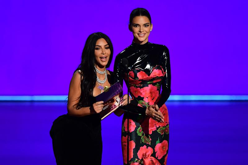 US television personalities Kim Kardashian and Kendall Jenner present the award for Outstanding Competition Program onstage during the 71st Emmy Awards