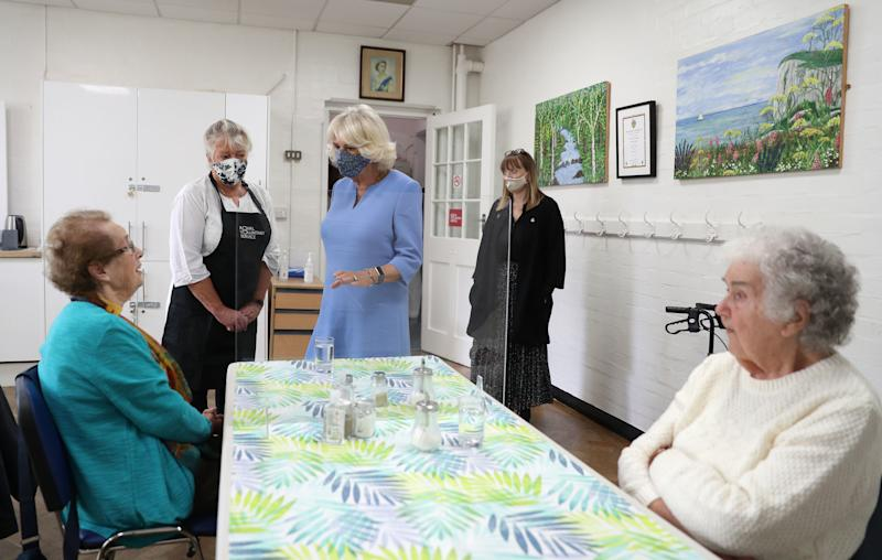 Britain's Camilla, Duchess of Cornwall, in her role as President, Royal Voluntary Service, gestures during a visit to the Royal Voluntary Service Mill End lunch club in Rickmansworth, Hertfordshire on October 8, 2020, to meet volunteers who have overcome recent challenges posed by the novel coronavirus COVID-19 pandemic to reinstate the much-needed lunch sessions. (Photo by Andrew Matthews / POOL / AFP) (Photo by ANDREW MATTHEWS/POOL/AFP via Getty Images)
