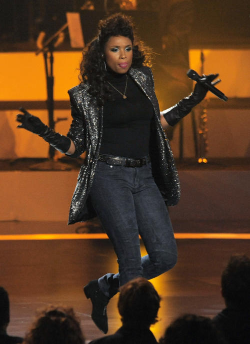 "Singer Jennifer Hudson performs onstage at ""We Will Always Love You: A Grammy Salute to Whitney Houston,"" at Nokia Theatre on Thursday, Oct. 11, 2012, in Los Angeles. The one-hour concert tribute will air on CBS on Nov. 16. (Photo by Chris Pizzello/Invision/AP)"