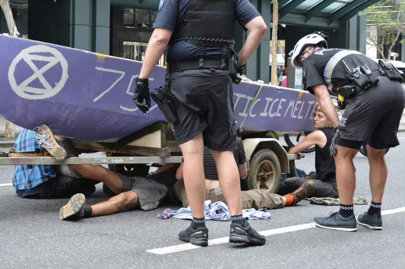 Police try and negotiate with protesters in Brisbane's CBD on Tuesday. Source: Extinction Rebellion