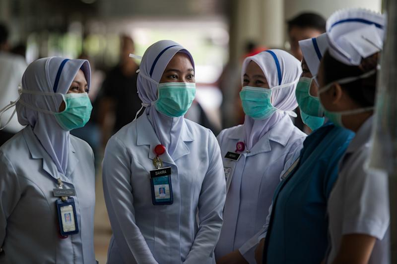 Medical personnel are seen at a hospital in Kuala Lumpur March 20, 2020. Health director-general Datuk Dr Noor Hisham Abdullah said 2,359 volunteers from various areas of healthcare across the country have been working with the MOH since the beginning of the outbreak and he is working to secure contracts for them. — Bernama pic