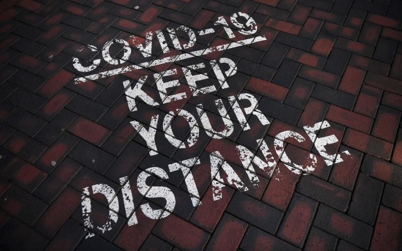 A Covid-19 social distancing public notice on a street in Birmingham - ANDY RAIN/EPA-EFE/Shutterstock