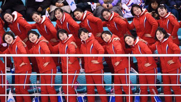 PHOTO: North Korea's cheerleaders leading cheers before the women's preliminary round ice hockey match between Switzerland and the Unified Korean team at the Kwandong Hockey Centre in Gangneung, South Korea, Feb. 10, 2018. (Jung Yeon-Je/AFP/Getty Images)