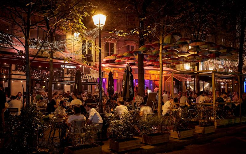 Parisians embrace the weekend in a packed bar as The French Health Ministry registered 10,593 new confirmed coronavirus cases over the past 24 hours in France, setting a new daily record on September 18, 2020 in Paris, France. - Kiran Ridley/Getty Images Europe