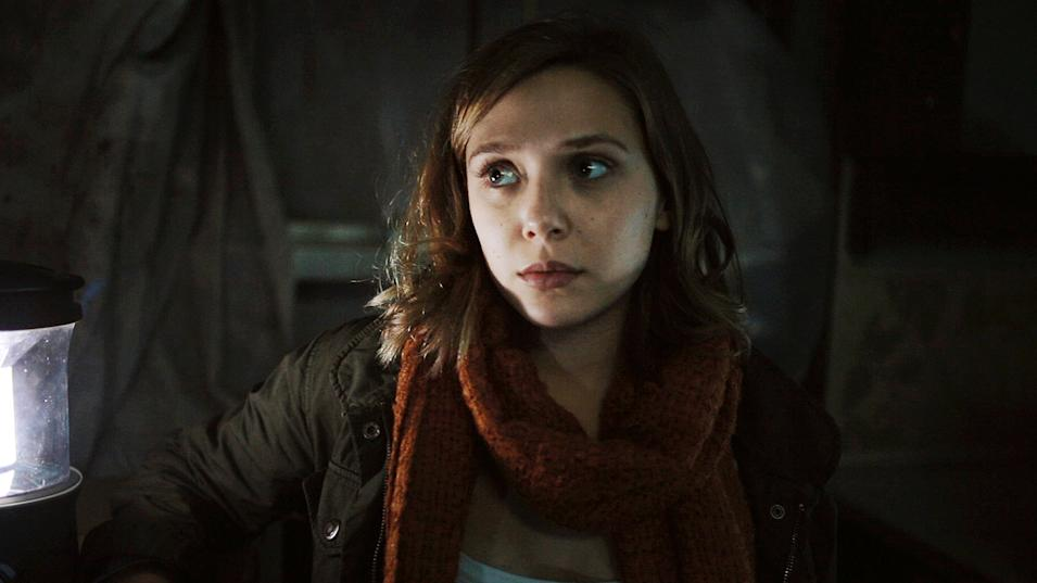 "In this film image released by Open Road Films, Elizabeth Olsen is shown in a scene from ""Silent House."" (AP Photo/Open Road Films)"