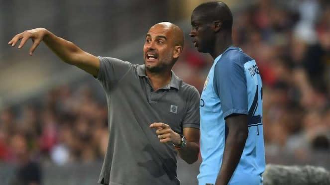 Pep Guardiola (kiri) dan Yaya Toure (kanan)