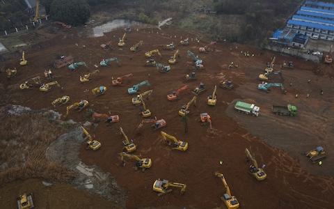 An army of excavators prepare the ground for a 1,000 bed hospital for coronavirus patients, which the Chinese authorities say will be ready in 10 days - Credit: Getty Images