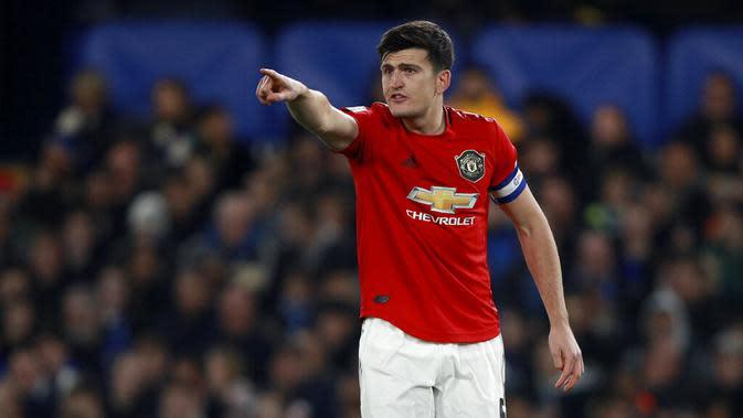 Kapten Manchester United, Harry Maguire, saat melawan Chelsea pada laga Piala Liga Inggris 2019 di Stadion Anfield, Rabu (30/10). Manchester United menang 2-1 atas Chelsea. (AP/Ian Walton)
